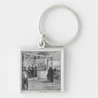 The Prince of Wales laying the Silver-Colored Square Keychain