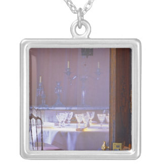 The private dining room with the black crystal square pendant necklace