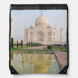 The quiet peaceful Taj Mahal at sunrise one of Drawstring Backpack