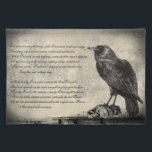 """The Raven Distressed Style Gothic Horror Cloth Placemat<br><div class=""""desc"""">This gothic horror inspired custom placemat has a distressed,  grunge effect background with a large black raven sitting ominously upon shrunken human skulls. Extracts of the Edgar Allan Poe poem The Raven have been added in a decorative script style font. Perfect for Halloween.</div>"""