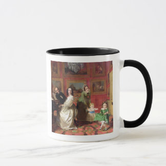 The Rev. and Mrs Palmer-Lovell with their daughter Mug