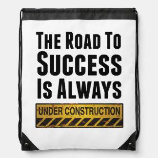The road to success drawstring bag