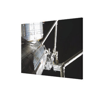 The robotic arm of the Japanese Experiment Modu 2 Canvas Print
