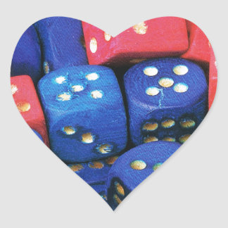 The roll of a dice heart sticker