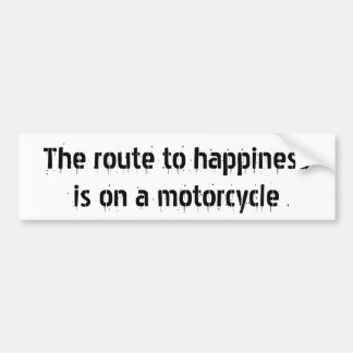 The route to happinessis on a motorcycle car bumper sticker