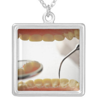 The scene which treatment is taken with a square pendant necklace