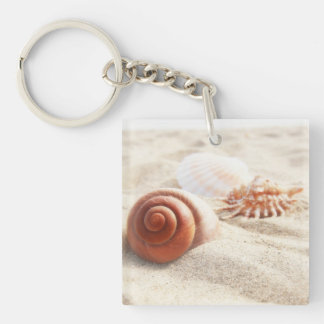 The seashells on the sand close up keychain