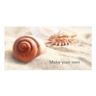 The seashells on the sand close up photo card