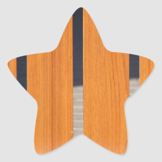 The seat is wooden benches closeup star sticker