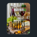 """The secret ingredient is always cheese saying magnet<br><div class=""""desc"""">For all cheese lovers out there! A beautiful photo of cheese and wine and a funny cheese quote.</div>"""