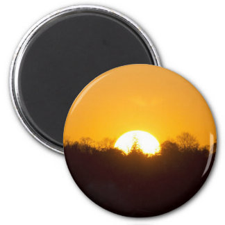 The Setting Sun Beyond The Trees 2 Inch Round Magnet