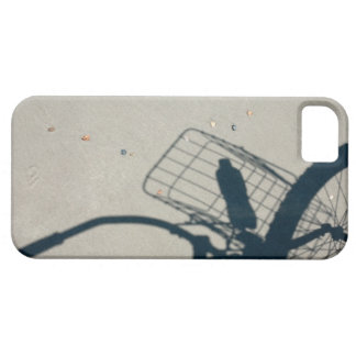 The shadow of a bicycle with a bottle of water iPhone 5 covers