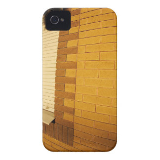 The shadow of a man on the illuminated wall of a h Case-Mate iPhone 4 case
