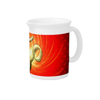 The sign om in gold beverage pitchers