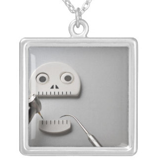 The skeleton which dental treatment is taken silver plated necklace