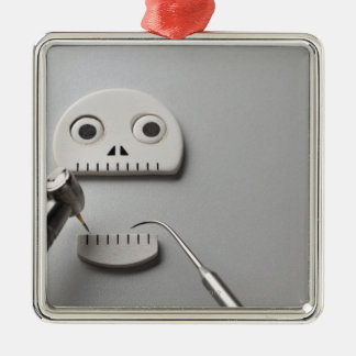 The skeleton which dental treatment is taken square metal christmas ornament