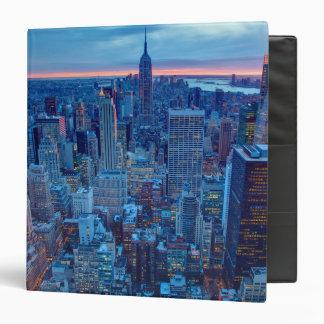 The skyscrapers of Manhattan are lit Vinyl Binder