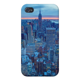 The skyscrapers of Manhattan are lit iPhone 4 Cover