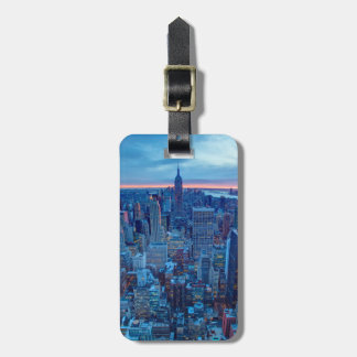 The skyscrapers of Manhattan are lit Luggage Tag
