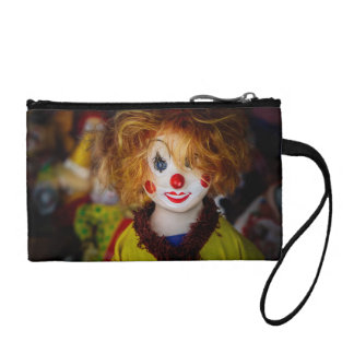 The smile on a clown toy change purse