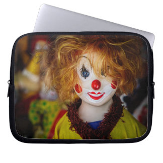 The smile on a clown toy laptop sleeve
