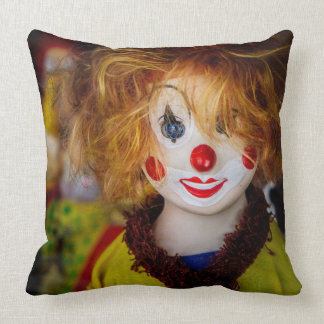 The smile on a clown toy throw pillow