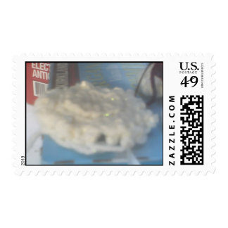 the snowy flying saucer of yarn postage stamp