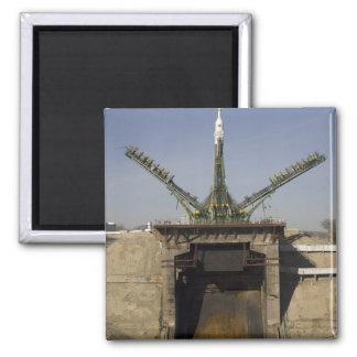 The Soyuz rocket is erected into position 3 Refrigerator Magnet