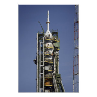 The Soyuz rocket is erected into position 3 Posters