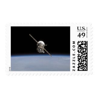 The Soyuz TMA-11 spacecraft above Earth's horiz Postage