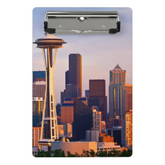 The Space Needle is a tower at dusk in Seattle Mini Clipboard