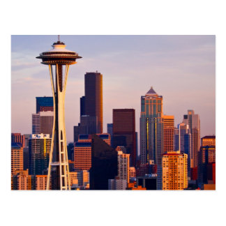 The Space Needle is a tower at dusk in Seattle Postcard