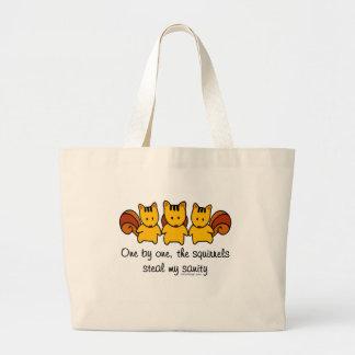 The squirrels steal my sanity large tote bag