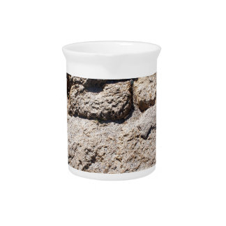 The stones from the limestone on the beach drink pitcher