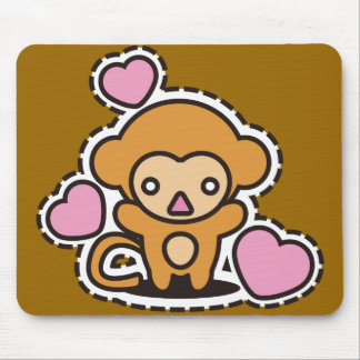The stuffed toy of the monkey mouse pad