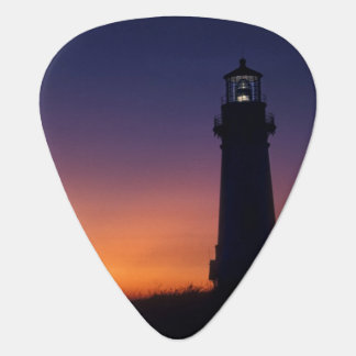 The sun ball drops down on the colorful horizon guitar pick