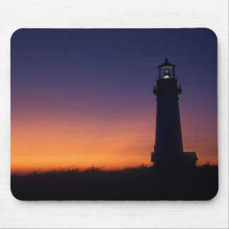The sun ball drops down on the colorful horizon mouse pad