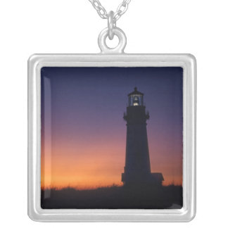 The sun ball drops down on the colorful horizon silver plated necklace