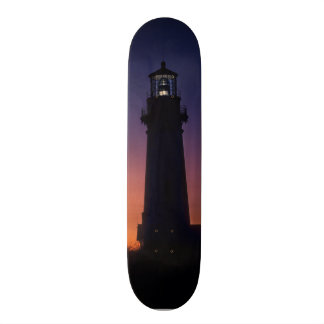 The sun ball drops down on the colorful horizon skateboard