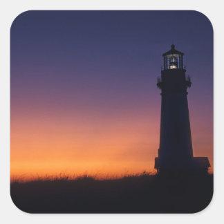 The sun ball drops down on the colorful horizon square sticker