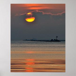 The sun emerges through an off-shore fog bank poster
