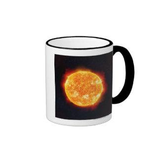 The Sun que muestra llamaradas solares contra una Taza De Dos Colores