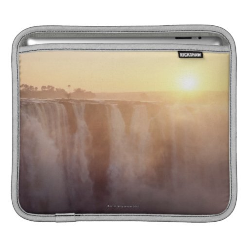 The sun rises behind the spray from Victoria Sleeve For iPads