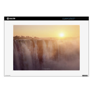 The sun rises behind the spray from Victoria Laptop Decal