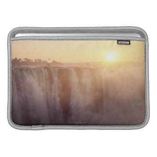 The sun rises behind the spray from Victoria MacBook Sleeve