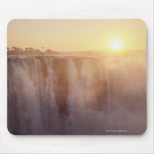 The sun rises behind the spray from Victoria Mouse Pad