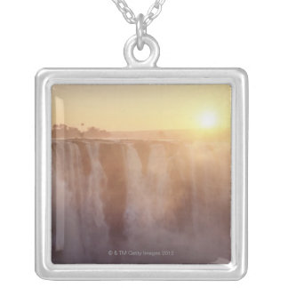 The sun rises behind the spray from Victoria Silver Plated Necklace