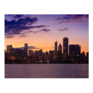The sun sets over the Chicago skyline Postcard