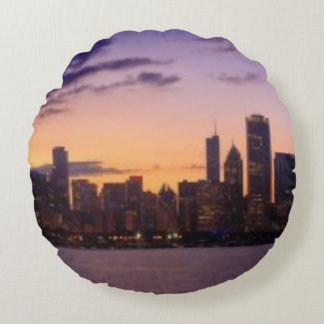 The sun sets over the Chicago skyline Round Pillow