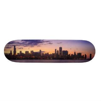 The sun sets over the Chicago skyline Skateboard